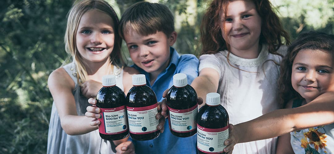 happy children smiling holding bio live probiotics