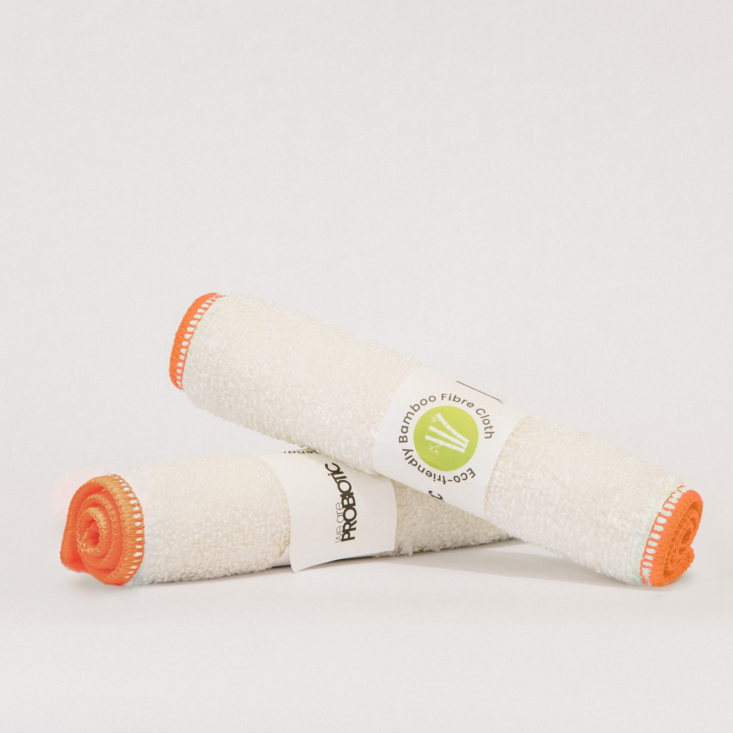 a pair of bamboo cleaning cloths - white with orange trim