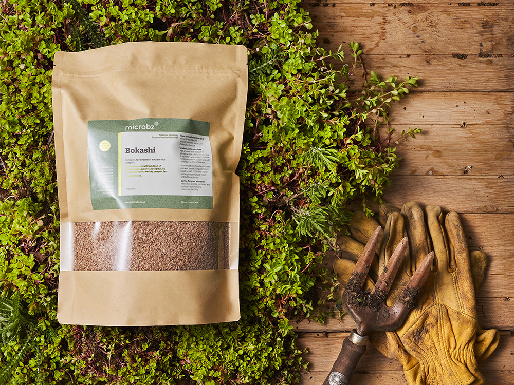an image of a packet of Bokashi lying on a bed of moss